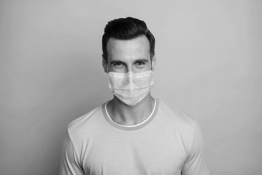Man wearing facemask in waxing salon, Male waxing Broadstone, Male grooming Broadstone